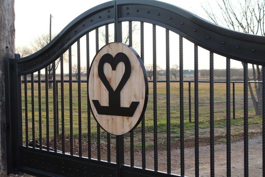 wood accented brand in ranch gate