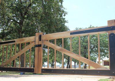 woodgrain painted iron driveway gate