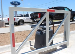 one side of dual swing security gate with F-1