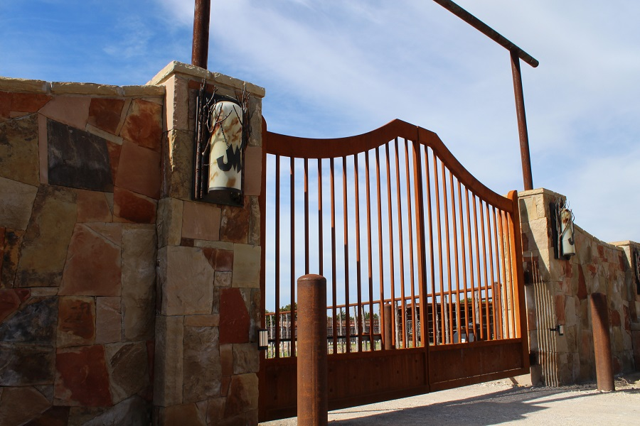 gate with rustic personalized light sconces