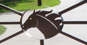 close up racehorse iron gate