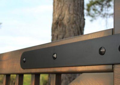 matte black bracket detail with rivets