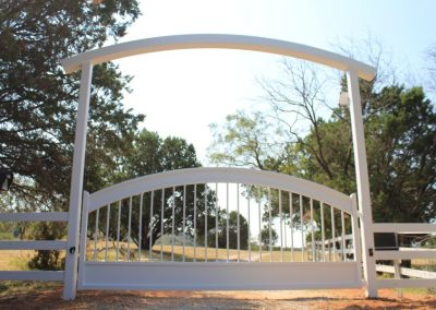 white gate with overhead arch