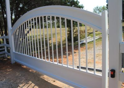 white washed arched iron gate